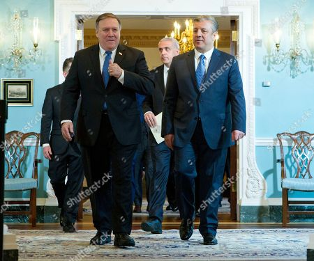 Stock Picture of Secretary of State Mike Pompeo accompanied by Georgian Prime Minister Giorgi Kvirikashvili, arrives for a news conference before their bilateral meeting at State Department, in Washington