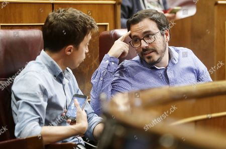 Izquierda Unida (IU, United Left) party leader Alberto Garzon (R) and Podemos MP Inigo Errejon (L) speak during the 2018 Budget debate at the Lower House in Madrid, Spain, 21 May 2018. MPs will vote for the amendments to the 2018 Budget.