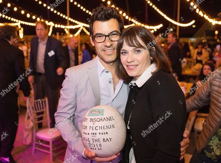 Stock Image of Jacob Pechenik, Zooey Deschanel. Jacob Pechenik and Zooey Deschanel attend the 2018 Heal the Bay Bring Back the Beach Annual Awards Gala, celebrating the accomplishments of honorees Los Angeles Mayor Eric Garcetti, Univision news anchor Gabriela Teissier and sustainability advocates Zooey Deschanel and Jacob Pechenik at The Jonathan Club on Thursday, May 17, in Santa Monica, CA