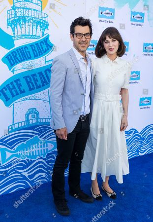 Jacob Pechenik, Zooey Deschanel. Jacob Pechenik and Zooey Deschanel arrive at the 2018 Heal the Bay Bring Back the Beach Gala, celebrating the accomplishments of honorees Los Angeles Mayor Eric Garcetti, Univision news anchor Gabriela Teissier and sustainability advocates Zooey Deschanel and Jacob Pechenik at The Jonathan Club on Thursday, May 17, in Santa Monica, CA