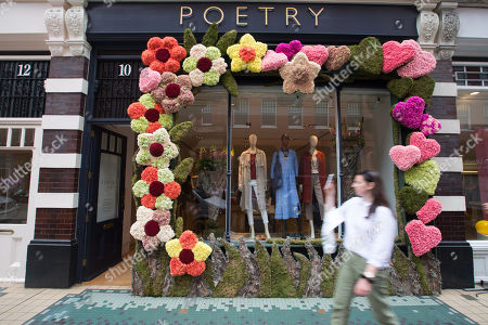 The Poetry display by Rob Van Helden off Sloane Square part of Chelsea in Bloom which extends the RHS Flower Show out into the local neighbourhood, organised by Cadogan in association with the RHS. This year?s theme is ?Summer of Love? and sees a record 65 businesses taking part. www.chelseainbloom.co.uk
