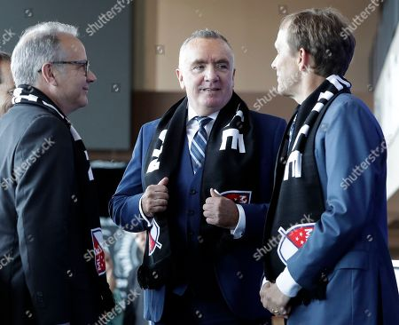 Ian Ayre, John Ingram, David Briley. Ian Ayre, center, talks with Mayor David Briley, left, and John Ingram, right, after Ayre was introduced as the first chief executive officer of the Nashville MLS franchise, in Nashville, Tenn. Ayre is a former CEO of the Liverpool Football Club of the English Premier League. Ingram is the lead owner the Nashville franchise