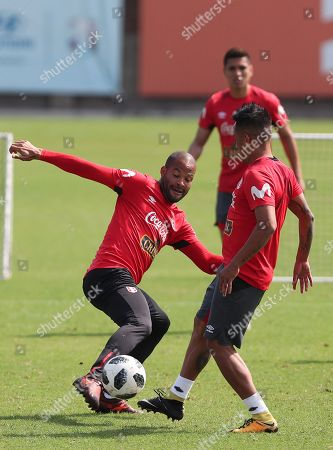 Peruvian player Alberto Rodriguez (L) participates in a training of the Peruvian soccer team, in the Videna of the city of Lima, Peru, 21 May 2018. Peru is preparing for a friendly match with Scotland in Lima and then start a tour of Europe where it will face the combined Saudi Arabia and Sweden, in preparation for the 2018 World Cup in Russia.