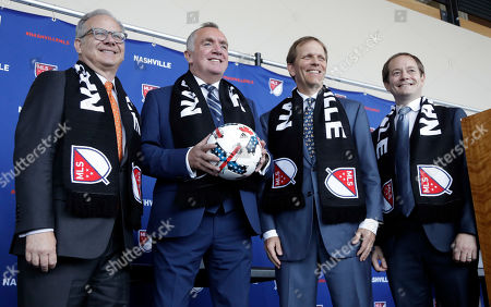 Ian Ayre, John Ingram, David Briley, WIll Alexander. Ian Ayre, second from left, poses for pictures after being introduced as the first chief executive officer of the Nashville MLS franchise, in Nashville, Tenn. Ayre is a former CEO of the Liverpool Football Club of the English Premier League. From left are Nashville Mayor David Briley, Ayre, lead owner John Ingram, and emcee Will Alexander
