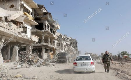 A general view over destroyed parts of al-Hajar al-Aswad neighborhood in south Damascus, Syria, 21 May 2018. According to reports, the Syrian army claims it has regained full control over Damascus' surrounding areas. State TV reports that the army cleared the area and the adjacent al-Yarmouk camp after killing large number of ISIS fighters.