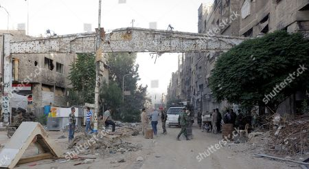 A general view shows the destroyed entrance of  the Yarmouk camp neighborhood in south Damascus, Syria, 21 May 2018. According to reports, the Syrian army claims it has regained full control over Damascus' surrounding areas. State TV reports that the army cleared the area and the adjacent al-Yarmouk camp after killing large number of ISIS fighters.
