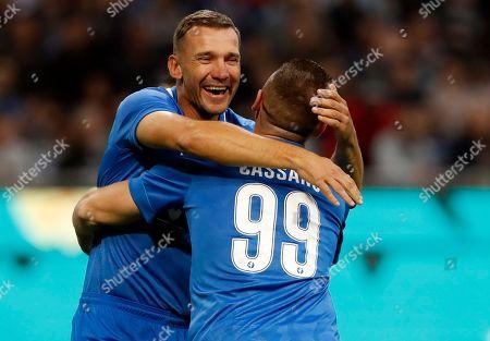 Andriy Shevcenko, left, hugs Antonio Cassano after scoring, during Andrea Pirlo farewell exhibition match, at the Milan San Siro Stadium, Italy