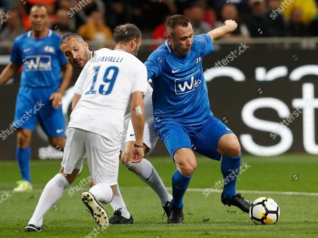 Antonio Cassano, right, is challenged by Giuseppe Favalli and Gianluca Zambrotta, during Andrea Pirlo farewell exhibition match, at the Milan San Siro Stadium, Italy