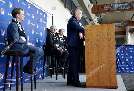 Ian Ayre, right, speaks after being introduced as the first chief executive officer of the Nashville MLS franchise, in Nashville, Tenn. Ayre is a former CEO of Liverpool Football Club of the English Premier League