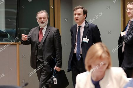 Britain's trade minister Greg Hands (C) and and British ambassador to the EU Tim Barrow (L) arrive at a European foreign affairs council on trade in Brussels, Belgium, 22 May 2018. EU ministers will exchange views on trade relations with the United States.