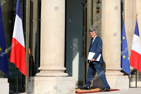 Former French Environment minister Jean-Louis Borloo, in charge of a mission on the priority neighbourhoods in the French urban policy, arrives at the presentation of the French government's battle plan for the country's most deprived areas, in Paris