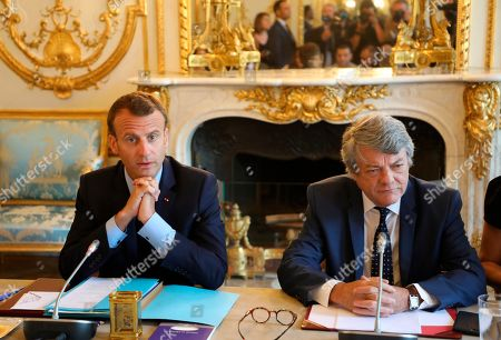 French President Emmanuel Macron, left, and former French Environment minister Jean-Louis Borloo, in charge of a mission on the priority neighbourhoods in the French urban policy, arrives at the presentation of the French government's battle plan for the country's most deprived areas, in Paris