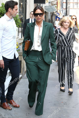 Victoria Beckham leaving her Dover Street store with mother Jackie Adams