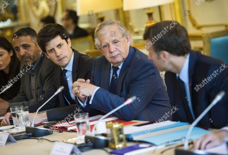 French president Emmanuel Macron (R), flanked by (fromL) French Minister of State for the Territorial Cohesion Julien Denormandie, French Minister of Agriculture and Food Jacques Mezard and former French Environment minister Jean-Louis Borloo, in charge of a mission on the priority neighbourhoods in the French urban policy