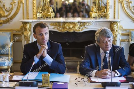 French President Emmanuel Macron speaks, flanked by former Environment Minister Jean-Louis Borloo, in charge of a mission on the priority neighbourhoods in the French urban policy
