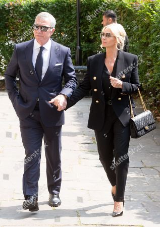 Football pundit and former player Graeme Souness with his wife Karen, arrives for the funeral of Dale Winton
