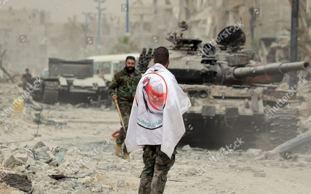 Syrian soldiers patrol at the Yarmouk Camp district in south Damascus, Syria, 22 May 2018. Media reports state the Syrian government of Bashar al-Assad on 21 May recaptured the last area of Damascus under opposition control and took full control of the capital for the first time since the outbreak of the civil war in 2011, after groups of Islamic State (IS) fighters holed up in an area of south Damascus, including the Palestinian refugee camp Yarmouk, were bussed out.