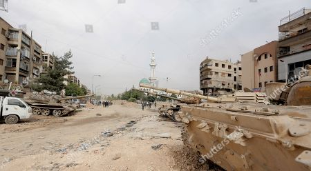 Tanks are seen at the Yarmouk Camp district in south Damascus, Syria, 22 May 2018. Media reports state the Syrian government of Bashar al-Assad on 21 May recaptured the last area of Damascus under opposition control and took full control of the capital for the first time since the outbreak of the civil war in 2011, after groups of Islamic State (IS) fighters holed up in an area of south Damascus, including the Palestinian refugee camp Yarmouk, were bussed out.
