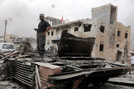 A Syrian soldier stands atop a tank at the Yarmouk Camp district in south Damascus, Syria, 22 May 2018. Media reports state the Syrian government of Bashar al-Assad on 21 May recaptured the last area of Damascus under opposition control and took full control of the capital for the first time since the outbreak of the civil war in 2011, after groups of Islamic State (IS) fighters holed up in an area of south Damascus, including the Palestinian refugee camp Yarmouk, were bussed out.stockképe