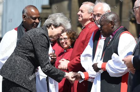 Archbishop of York John Sentamu, the Archbishop of York (R) greets Theresa May as she arrive to attend The Manchester Arena National Service of Commemoration at Manchester Cathedral in central Manchester on May 22, 2018, on the one year anniversary of the deadly attack at Manchester Arena