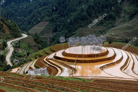 A general view of an art installation 'Crystal Cloud' on a terraced rice field in La Pan Tan commune, Mu Cang Chai, Yen Bai province, 22 May 2018. The project by two landscape designers Andy Cao and Xavier Perrot, featured around 58,000 crystal beads, has bought different opinions from the public as people concern it may harm the natural scenery. The 'Crystal Cloud' exhibition was expected to open for tourists for five months at first, has now shortened to two weeks, starting from 19 May 2018, according to local media. It costs each visitor 30,000 VND (around 1,5 US dollars) to by a ticket for the exhibition.