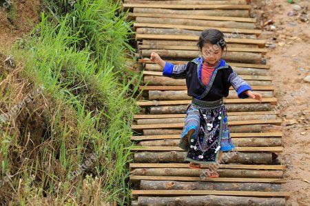 A Vietnamese ethnic girl plays in La Pan Tan commune, Mu Cang Chai, Yen Bai province, 22 May 2018.
