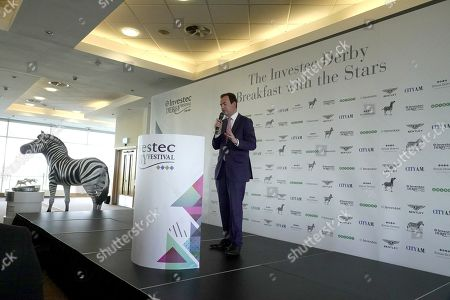 """Stock Picture of Nick Luck, TV announcer previews """"Breakfast with the Stars"""" a preview for horses entered for The Derby and Oaks horse races on June 1st and 2nd, working out on the racecourse ahead of the event"""