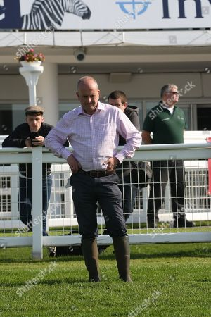 """Andrew Cooper, Clerk of the Course at Epsom Downs, contemplates the ground in the midst of a difficult weather pattern prior to The Derby and Oaks horse races on June 1st and 2nd, work out on the racecourse ahead of the event in a preview called """"Breakfast with the Stars"""""""