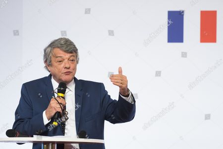 Jean-Louis Borloo gestures as he speaks during the presentation of the French government's battle plan for the country's most deprived areas, on May 22, 2018 in Paris.