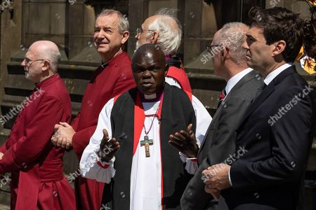Dignitaries, including Archbishop of York John Sentamu, SIR Richard Leese and Andy Burnham, wait to receive guests at Manchester Cathedral ahead of a Service of Remembrance on the first anniversary of the Manchester Arena bombing.