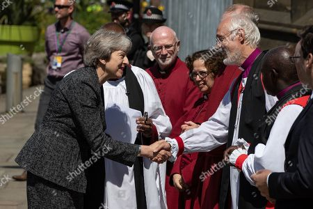Prime Minister Theresa May is greeted by dignitaries, including Bishop David Walker (shaking hands) Archbishop of York John Sentamu, SIR Richard Leese and Andy Burnham, wait to receive guests at Manchester Cathedral ahead of a Service of Remembrance on the first anniversary of the Manchester Arena bombing.