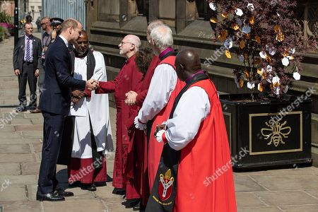Prince William is greeted by dignitaries, including Bishop David Walker Archbishop of York John Sentamu, SIR Richard Leese and Andy Burnham (shaking hands), at Manchester Cathedral ahead of a Service of Remembrance on the first anniversary of the Manchester Arena bombing.