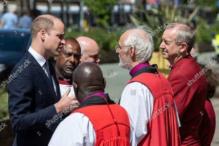 Stock Photo of Prince William is greeted by dignitaries, including Bishop David Walker, Archbishop of York John Sentamu, SIR Richard Leese and Andy Burnham (shaking hands), at Manchester Cathedral ahead of a Service of Remembrance on the first anniversary of the Manchester Arena bombing.