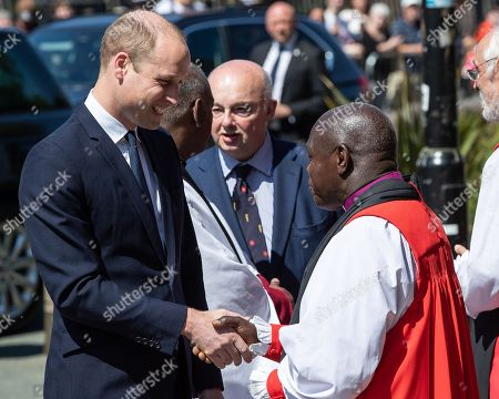 Prince William is greeted by dignitaries, including Archbishop of York John Sentamu at Manchester Cathedral ahead of a Service of Remembrance on the first anniversary of the Manchester Arena bombing.