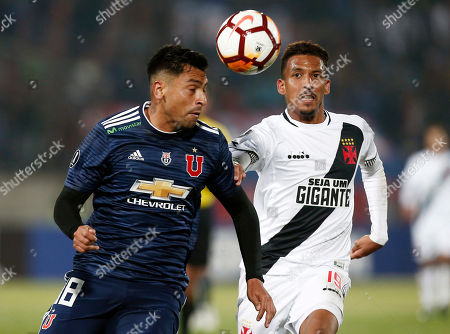 Gonzalo Jara of Chile's Universidad de Chile, left, and Caio Monteiro of Brazil's Vasco da Gama, go for the ball during a Copa Libertadores soccer match in Santiago, Chile