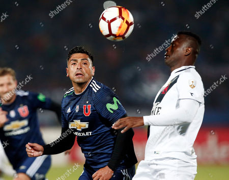 Gonzalo Jara of Chile's Universidad de Chile, left, and Riascos of Brazil's Vasco da Gama, go for the ball during a Copa Libertadores soccer match in Santiago, Chile