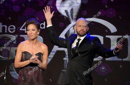 Lisa Joyner, Jon Cryer. Lisa Joyner, left, and Jon Cryer speak at the 43rd annual Gracie Awards at the Beverly Wilshire Hotel, in Beverly Hills, Calif