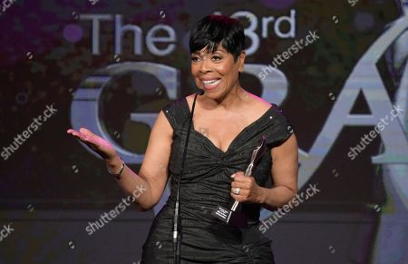"Shirley Strawberry accepts the award for best co-host - national for ""The Steve Harvey Morning Show"" at the 43rd annual Gracie Awards at the Beverly Wilshire Hotel, in Beverly Hills, Calif"