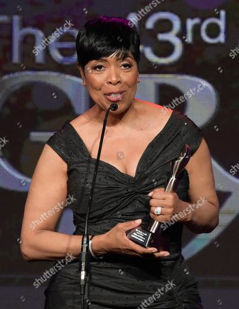 "Stock Image of Shirley Strawberry accepts the award for best co-host - national for ""The Steve Harvey Morning Show"" at the 43rd annual Gracie Awards at the Beverly Wilshire Hotel, in Beverly Hills, Calif"