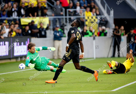 Los Angeles FC forward Adama Diomande, center, reacts after missing a shot against Borussia Dortmund goalkeeper Roman Weidenfeller, left, during the first half of an international friendly soccer match in Los Angeles