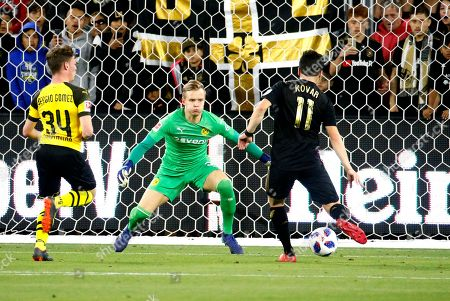 Borussia Dortmund goalkeeper Roman Weidenfeller, center, defends as Los Angeles FC midfielder Aaron Kovar, right, shoots during the second half of an international friendly soccer match in Los Angeles, . The game ended in a 1-1 draw