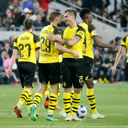 Borussia Dortmund forward Maximilian Philipp, second from right, celebrates with Marcel Schmelzer (29) during the second half of an international friendly soccer match against Los Angeles FC in Los Angeles, . The game ended in a 1-1 draw