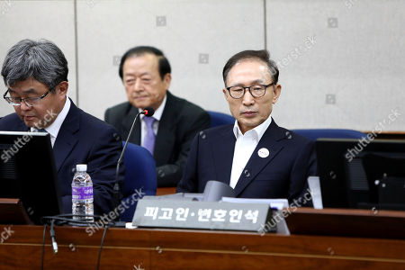 Former South Korean President Lee Myung-bak appears for his first trial at the Seoul Central District Court in Seoul . A South Korea court issued an arrest warrant for Lee on corruption charges on March 23, 2018