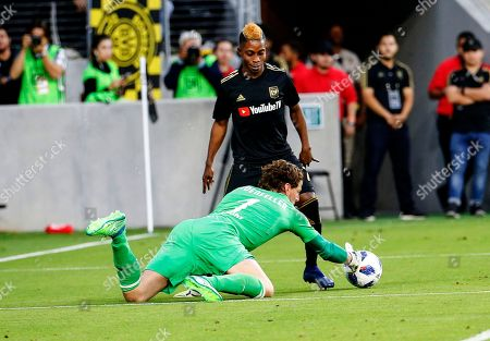Borussia Dortmund goalkeeper Roman Weidenfeller (1) of Germany, and Los Angeles FC forward Latif Blessing (7) of Ghana in actions during an international friendly soccer game between Los Angeles FC and Borussia Dortmund in Los Angeles, . The game ended in a 1-1 draw