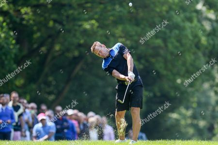 Teddy Sheringham hits out of the rough during the Celebrity Pro-Am day at Wentworth Club, Virginia Water. Picture by Phil Duncan