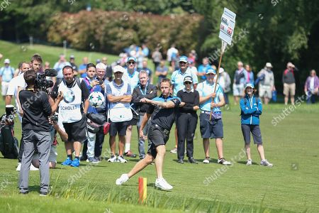 Teddy Sheringham kicks a football onto the 18th green during the Celebrity Pro-Am day at Wentworth Club, Virginia Water. Picture by Phil Duncan