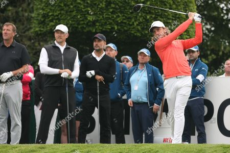 Pep Guardiola, Peter Schmeichel and Matt Le Tissier watch as Tommy Fleetwood drives from the first tee
