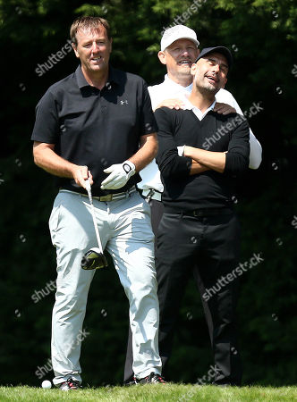 Matt Le Tissier with Manchester City Manager Pep Guardiola gets a shoulder rub from Ex Manchester United player Peter Schmeichel during his round.