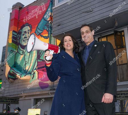 Christine Pelosi, left, and Stuart Milk unveil this Stoli Vodka-commissioned mural celebrating Harvey Milk Day, in San Francisco