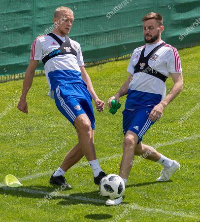 (L-R) Igor Smolnikov and Vladimir Granat of Russia take part in a training session in Neustift im Stubaital, Austria, 21 May 2018. The Russian team prepares for the World Cup 2018 in Neustift im Stubaital.